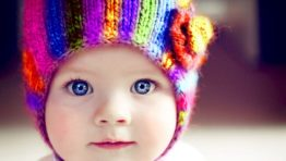 Cute Baby With Rainbow Colored Bonnet