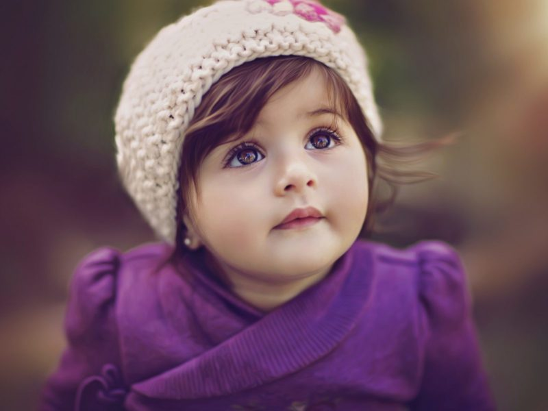Cute baby girl in purple dress