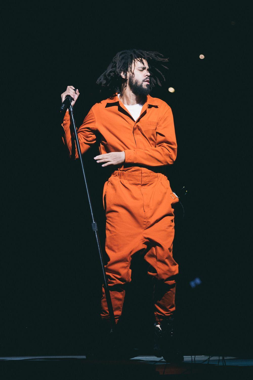 J Cole Prison Suit Wallpaper Hd Download Free Hd Wallpapers